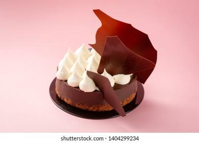 Modern dessert chocolate tart and cream