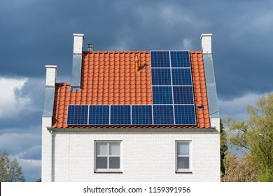 modern detached houses in the netherlands with solar panels on the roof