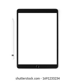 Modern device the tablet with white stylus on isolated light background. Black tablet computer with blank screen, isolated on white background. Technology Concept.