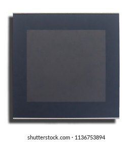 Modern digital programmable thermostat with liquid crystal touch screen and dark panel on a white background