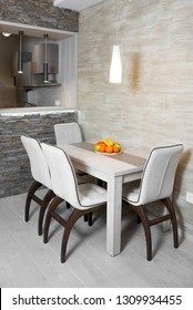 Modern dine table with the kitchen in the back