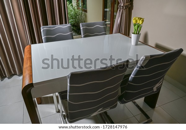 Modern dining furniture set view with flower bouquet on top