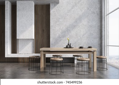 Modern dining room interior with concrete and wooden walls, a wooden table with round chairs near it, a loft window and a fireplace. 3d rendering mock up