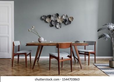 Modern dining room interior with glamour wooden table , stylish chairs and design decoration. Template. Home decor.