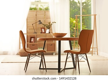 Modern dining room interior with table and chairs