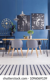 Modern dining set furniture in a vibrant open space interior with navy blue walls and stylish decor