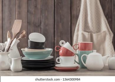 modern dinnerware on wooden background in kitchen