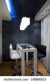 Modern dinning room with glass bar table