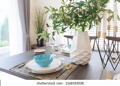 Modern dinning room interior with blue plate on wood table at home.