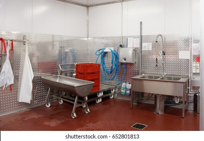 Modern dishwashing room at food processing plant
