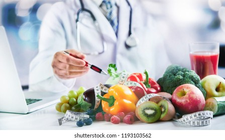 Modern doctor or pharmacy agent contact for healthy food and diet. A scene for Health concepts diet lost the plans with fresh vegetables and fruits