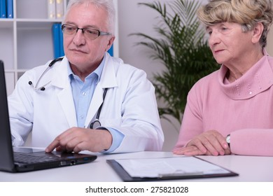 Modern doctor using laptop during medical consultation