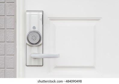 Modern door handle with security system lock on wood door