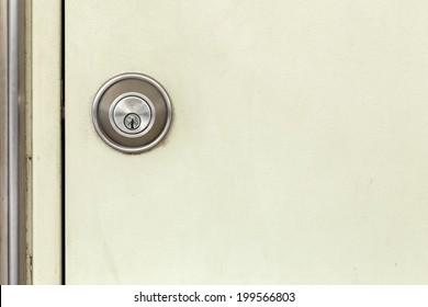 modern door locked cream white door background ,texture ,passage