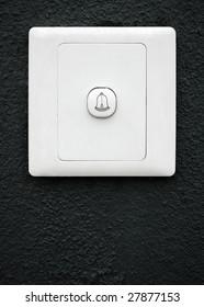 modern doorbell on black wall