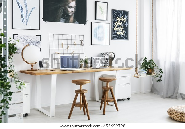 Modern double desk and two stools in trendy home office