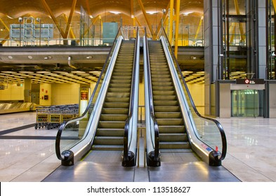 modern double escalator staircase  in airport leading up
