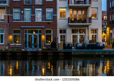 Modern Dutch buildings at the canal, City architecture by night, Alphen aan den Rijn, the Netherlands