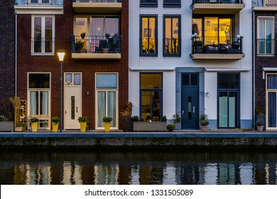 Modern dutch houses at the canal, city architecture by night, Alphen aan den Rijn, The Netherlands