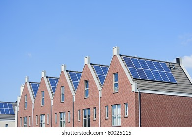 Modern Dutch houses with solar panels on roof