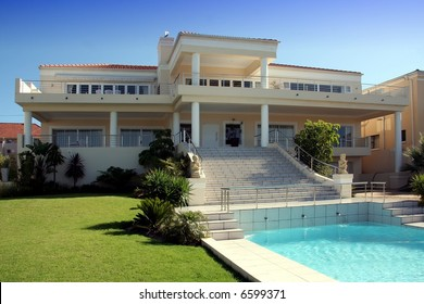 Modern dwelling with swimming pool and green lawn