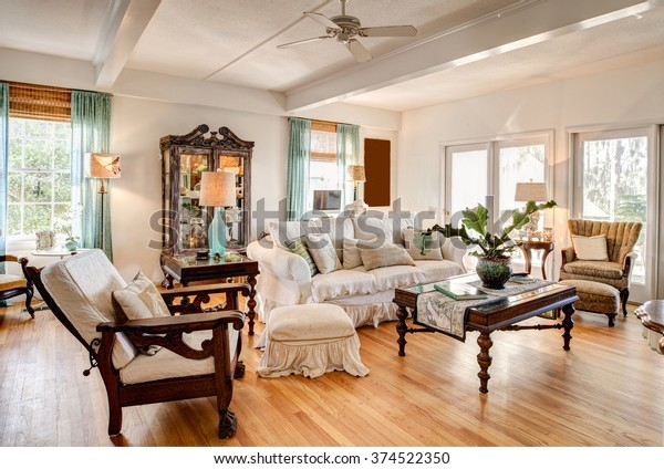 Modern eclectic livingroom with nice antique furniture.
