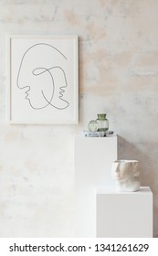 Modern and eclectic room interior with white stands , mock up poster frame, head sculpture and vase. Stylish space with design accessories. Eclectic home decor. Abstract wiped walls. Real photo.