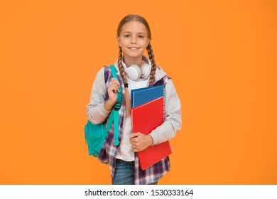 Modern education. Private schooling. Teen with backpack and books. Motivated and diligent. Stylish schoolgirl. Girl little fashionable schoolgirl carry backpack. Schoolgirl daily life. School club.