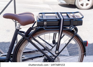 Modern electric bike battery on a cycle in the street