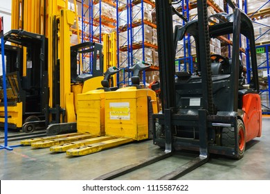 Modern electric forklift truck. Modern system of address storage of goods in a warehouse. Transport for loading and unloading. Shooting with high sensitivity and noise.