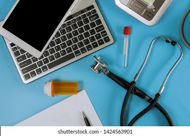 modern electric tonometer and a stethoscope on a laptop computer keyboard blood pressure monitor