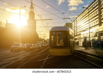 Modern electric tram yellow color on the streets of Berlin