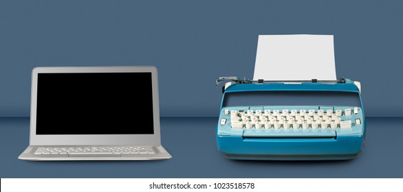 Modern electric typewriter alongside modern laptop on blue desk background with copy space