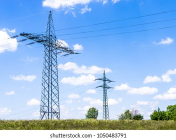 modern electricity pylons at a field near rome