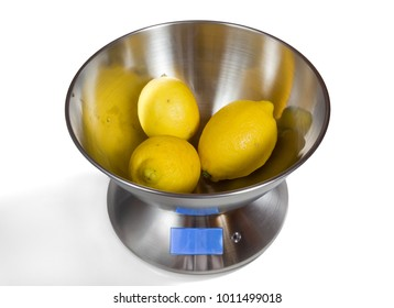 Modern electronic metal kitchen weighing scales with lemons
