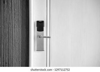 Modern Electronic Security door lock on white wooden door