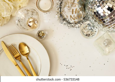 Modern and elegant New Year's Eve table setting overhead view with room for copy