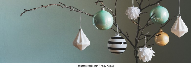 Modern and elegant simple nordic christmas tree decorations in black, white, gold and turquoise colors