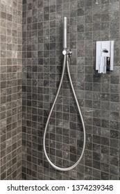 Modern elegant stainless steel shower head in the bathroom.