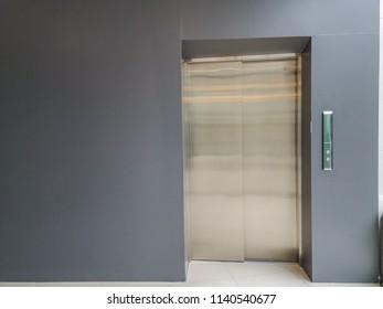 Modern elevator with grey wall,metal elevator