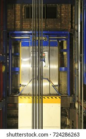 Modern elevator shaft interior with cables and tracks