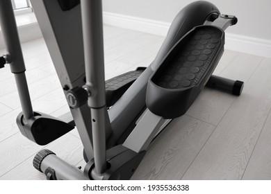 Modern elliptical machine cross trainer on floor indoors