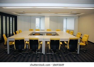 Modern empty business meeting conference room with yellow chair
