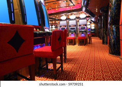 modern empty casino hall with game machines, side view