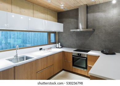 Modern empty kitchen with concrete wall