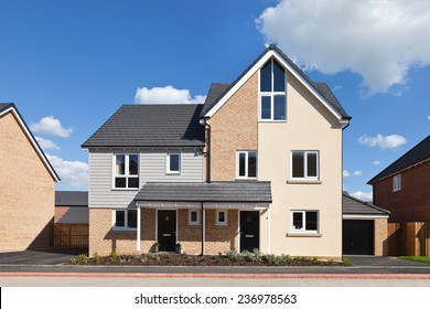 Modern english  semi - detached house with garage