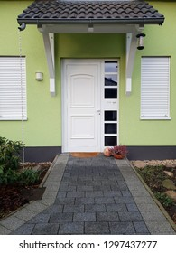 Modern entrance door with glass at the apartment building