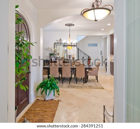 Modern Entrance Hall Lobby With The Stylish Wooden Door And Dining Room At Back Interior Design Of Luxury House
