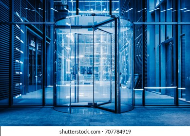modern entrance with revolving door,blue toned.