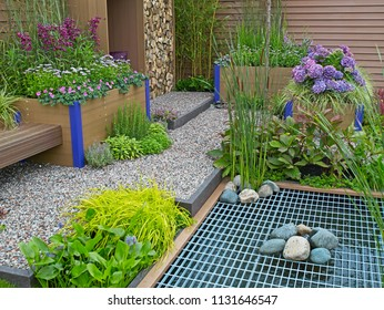A modern environmental garden with water saving and intergrated irrigation systems, plants and flowers